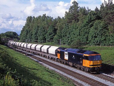 """60008 """"Gypsum Queen II"""" approaches Shap with the limestone empties from Redcar on 27/6/98."""