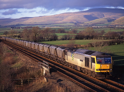 "60014 ""Alexander Fleming"" hauls a 7Z39 coal train past Keld on 21/2/98"