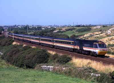 A Holyhead-Euston HST passes Llanfairyneubwll on 9/8/98.