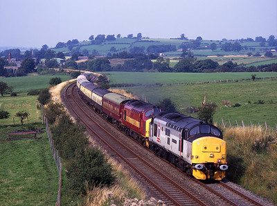 "37407 ""Blackpool Tower"" + 37416 power a Glasgow-Wolverhampton Regency charter near Langwathby on 30/8/98."