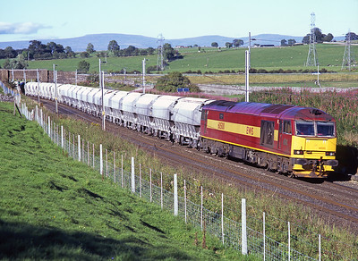 The daily limestone empties from Teesside-Hardendale pass Shap Beck behind 60500 24/8/07.
