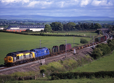 37058 + 37371 haul the evening Enterprise north of Milnthorpe on 21/6/99.