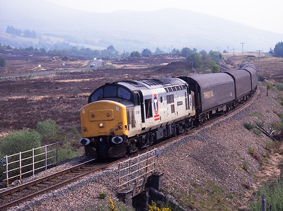 """37410 """"Aluminium 100"""" is seen west of Spean Bridge with a northbound freight on 14/5/98."""
