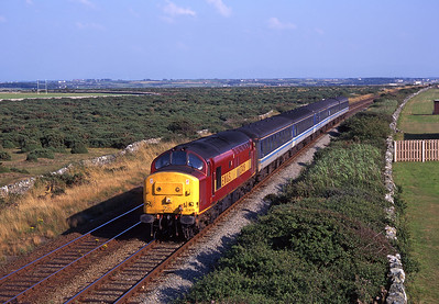 37419 passes Valley Airfield with a Holyhead bound train on 9/8/98.