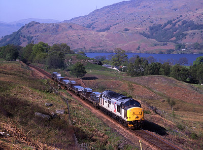 """37404 hauls the aluminium """"lumps"""" south of Ardlui with Loch Lomond in the background on 13/5/98."""