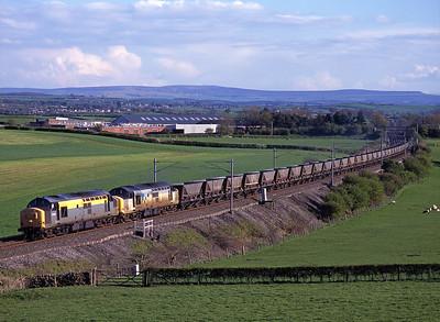 37377 + 37680 haul coal empties near Milnthorpe on 27/4/98.