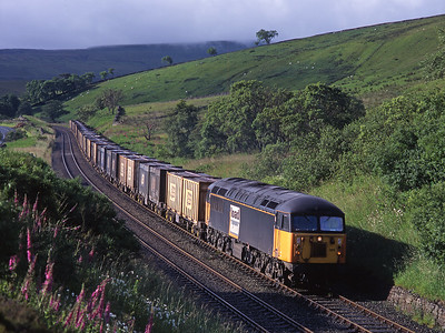 A rare use of a 56 on a gypsum train; 56085 approaches Shotlock tunnel on 13/7/98 with the morning Drax-Newbiggin.