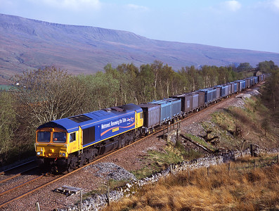 Far from London, Metronet liveried 66720 coasts along the Mallerstang valley with a gypsum train 6/5/08.