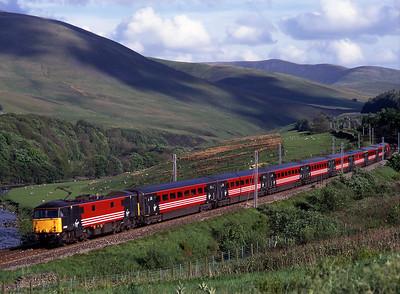 87008 hauls a Euston-Glasgow service through the Lune Gorge on 21/5/99.