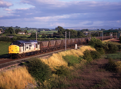 """37799 """"Sir Dyfed/County of Dyfed"""" passes Elmsfield with coal empties on 22/7/99."""