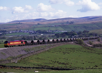 On May Day bank holiday 4/5/98 60012 passes Greenholme with coal empties.
