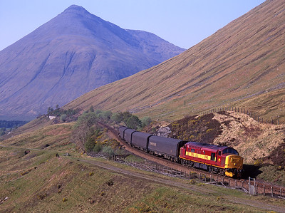 37413 passes County March summit with a southbound freight on 13/5/98.