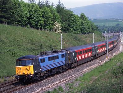 "86245 ""Caledonian"" passes Beckfoot on 30/5/98."