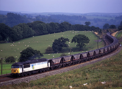 56061 passes Upper Denton with Milford-Hunterston coal empties on bank holiday Monday 31/8/98.