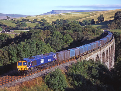 In lovely September light 66723 rolls across Smardale viaduct with a northbound gypsum train 7/9/07.