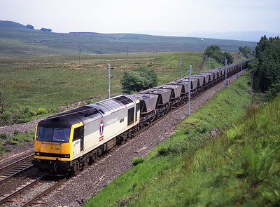 """60080 """"Kinder Scout"""" approaches Shap summit with coal empties on Saturday 20/6/98."""