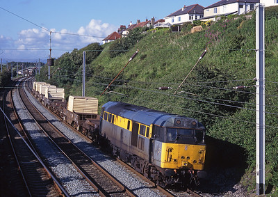 31166 passes Hest Bank with the Sellafield-Willesden flasks on 24/6/98/