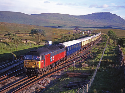 47763 passes Blea Moor with a Leeds-Kirkby Stephen VSOE on 29/6/99; 56025 was on the rear.