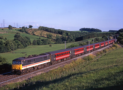 """87026 """"Sir Richard Arkwright"""" passes Great Strickland with a Euston-Carlisle train on 12/7/99."""