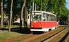 Tram 107 is seen bathed in evening sunshine at the Universitate stop Daugavpils 09/05/2018.