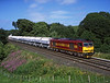 60047 seen at Milton with 6M46 Redcar to Hardendale lime hoppers<br /> 16/7/2005