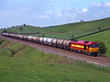 60018 Nr Gilsland with 6E48 Stanlow to Jarrow oil tanks<br /> 27/5/1997