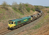 66558 On 4S08 the 09.00hrs Ferrybridge to Killoch empty coal passes through Cowran Cutting<br /> 20/04/2011