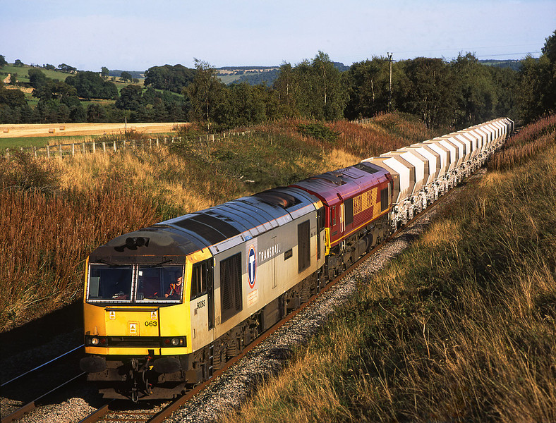 60063 + 66200 pass Ridley Hall on 6M46 the Redcar to Hardendale lime hoppers<br /> 20/9/2005