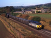 56076 Nr Ridley Hall with the 09.50hrs Melkridge to Eggbourgh coal<br /> 8/10/1997