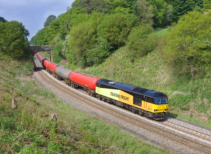 For once the weather forecast was correct and the further West I travelled the better the weather became ,60095 is seen on 6S36 the diverted 08.47hrs Dalston oil terminal - Grangemouthpassing through Cowran Cutting on the Tyne valley line.<br /> 28/05/2016
