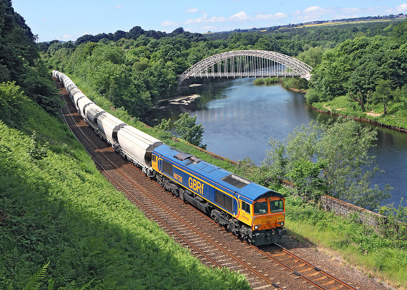 66735 is seen Nr Wylam on the scenic Tyne Valley route whilst working 6Z58 11.47hrs Hardendale - Lackenby limestone hoppers.<br /> 19/6/2013