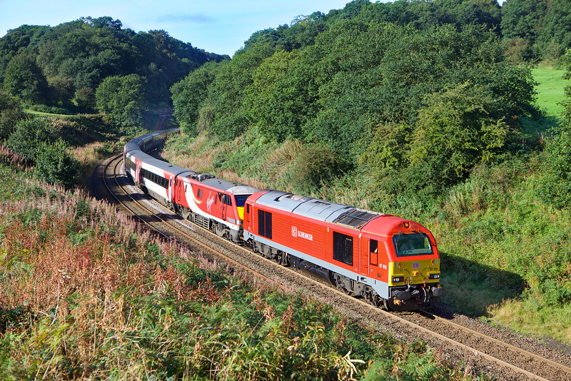 67015 drags 91121 with the diverted 1E06  the 08.24 Edinburgh to King's Cross through Cowran cutting on the Carlisle - Newcastle route.<br /> 17/9/2016.