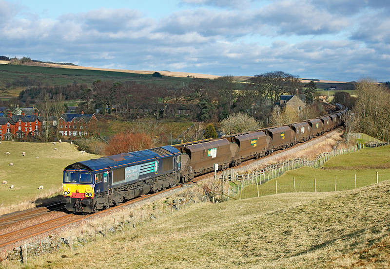 66415 passes Gilsland with 4Z60 the 08.57hrs Drax - Ravenstruther empty coal hoppers.	<br /> 15/02/2012