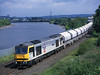 60056 seen skirting the River Tyne Nr Blaydon on 6M46 the Redcar to Hardendale Limestone hoppers<br /> 6/6/2003