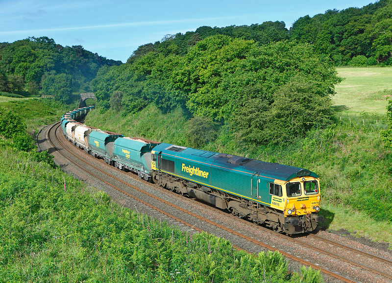 After missing the Nuclear flask due to convoy after convoy of lorries on the single carriage way of the A69 & it running early, 66615 was little consolation as it passes Cowran cutting with 6Z16 the 08.31hrs Carlisle yard to Redcar lime stone hoppers<br /> 18/6/2012