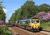 66559 is seen near Low Row on the Tyne Valley whilst working 4S15 the 12.57hrs Drax - Hunterston empty coal.<br /> 11/06/2014