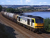 60095 runs along side the River Tyne on the approach to Blaydon on a Stanlow to Jarrow oil train<br /> 14/8/1996