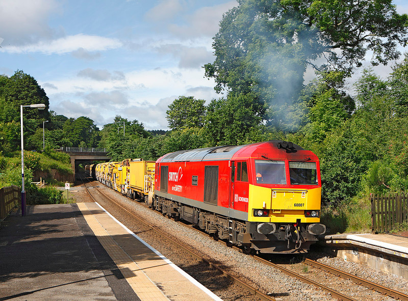 60007 is seen at Stocksfield about to leave an engineering possession with the HOBC which will crossover at Prudhoe before returning to Carlisle		<br /> 15/07/2012