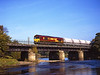 66086 on 6M46 Redcar to Hardendale crossing the river Tyne near Bardon Mill <br /> 6/10/2007