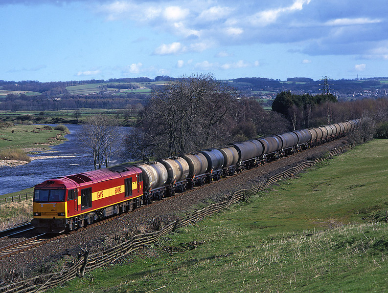 60043 Nr Hexham with a Jarrow to Stanlow empty oil train<br /> 3/4/1997