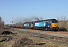 57003 + 57007 pass Howe & Co's sidingon 6K05 the 12.46hrs Carlisle - Basford Hall.12/03/2014