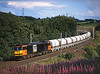 60008 passes Bessy Ghyll on a Beautifull summers evening on 6E61 Hardendale - Tyne yard limestone hoppers <br /> 31/7/2004