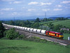 60065 passes Great Strickland on 6M46 Redcar - Hardendale limestone hoppers<br /> 7/6/2003
