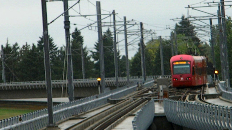 An inbound Central Link train departs the SeaTac airport station, rounds a curve, and heads for downtown Seattle on 10-8-11.