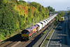66108 runs alongside the A63 and is about to pass under Livingstone Road, Hessle, shortly after departure from Hull Dairycoates with the 11:32 empty Tarmac hoppers to Rylstone on Thursday 10th October 2013.<br /> This location sports a very short window in which to catch the Autumn colours of the trees on the cutting before the shadows encroach too far across for the shot to be possible, as can be seen the trees are just beginning to turn.