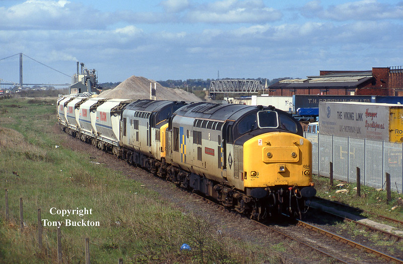 On Friday 3rd May 1996, 37684 and 37131 were trusted with the 6D03 / 6D04 Tilcon hoppers from Rylstone to Hull Dairycoates and return - photographed as they draw away from the terminal before running round to depart back to Rylstone. At this time class 60's were the normal traction, however,despite being unpopular with the customer, on an occasional basis class 37's were deliberately rostered for short periods to keep driver traction knowledge in order - much to the delight of the local enthusiasts.