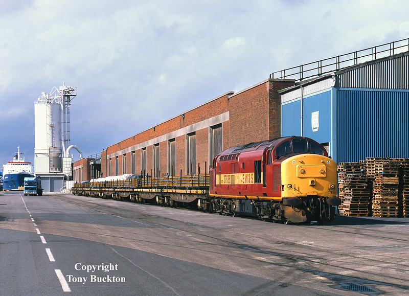 37688 stands on 10 Quay, Hull King George Dock, at 12:50 on September 28th 2000 with YLA Mullet's loaded with rails to Castleton.<br /> The locomotive was working as a super shunter off the daily Enterprise service from Doncaster, and would only work the rails as far as Hedon Road Sidings.
