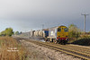 Under a dramatic sky, 20312 leads the 11:06 Stockbridge Works - York Thrall Europa railhead treatment train past Lowfield Lane, Melton,  en-route to Hull at 13:04 on Saturday 5th November 2016.