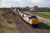 Railfreight Distribution liveried 37378 passes Southcoates Lane, Hull, on the afternoon of the 14th March 1994 with acetic acid tanks from Mostyn Dock to BP Chemicals at Hull Saltend.