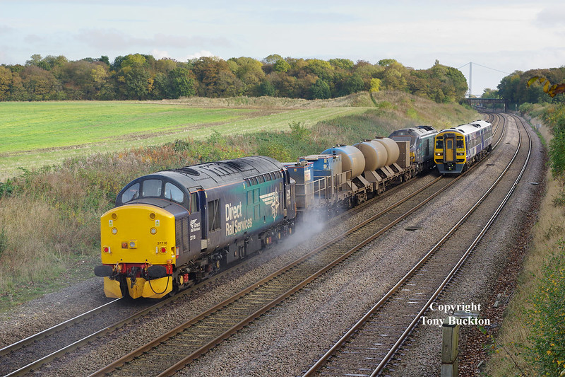 37716 brings up the rear of the 11:06 Stocksbridge works - York Thrall Europa Sandite on Saturday 29th 0ctober 2016 as the working passes Brickyard Lane, Melton en-route to Hull.